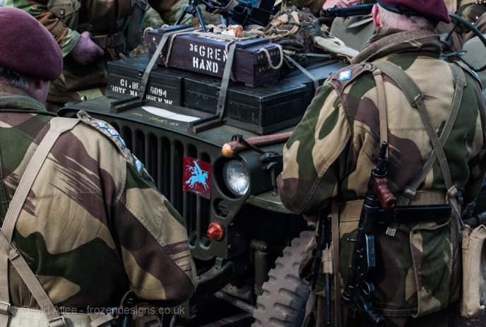 Soldiers stood around as jeep with a Pegasus badge on the radiator grill